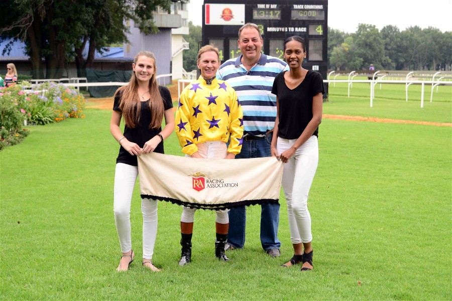 Jockey Piere Strydom with Clinton Binda after riding Seventh Son to victory at the Vaal for the Hollywood Syndicate