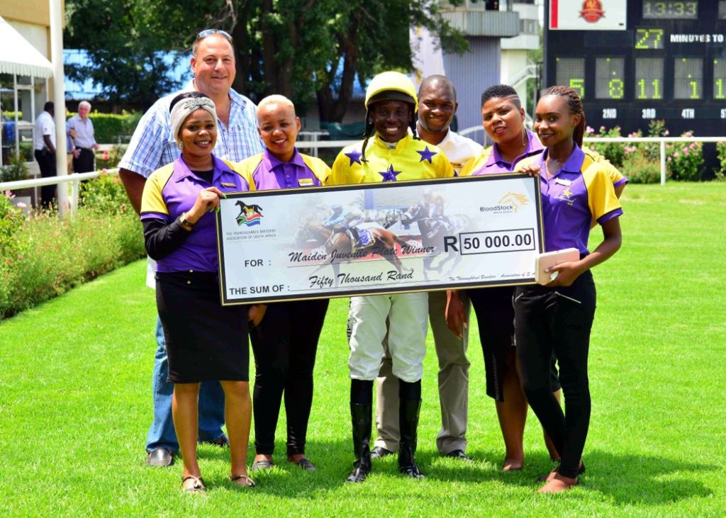 The Hollywoodbets team posing with jockey Kabelo Matsuyane and trainer Clinton Binda after LOOK TO THE SKY's victory at the Vaal