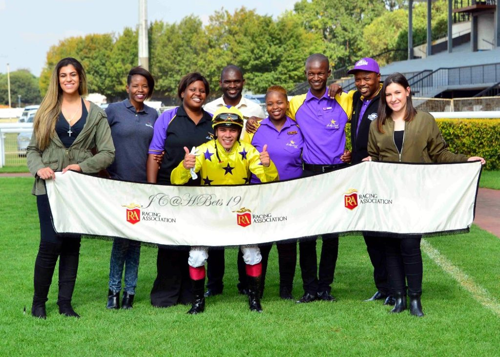 The Hollywoodbets Team posing for a Racing Association photo after the victory of Seattle Force at Turffontein. Ridden to victory by Diego De Gouvia and trained by Stuart Pettigrew.